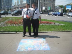 Elder Warren and Elder Gallo pose in front of their art.