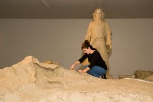 Angela Johnson sculpting clay.